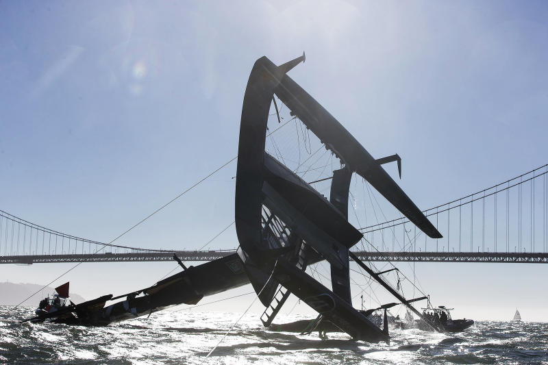In this photo taken Tuesday Oct. 16, 2012 and provided by Oracle Team USA, the Oracle Team USA AC72 catamaran is capsized on San Francisco Bay in San Francisco. The America's Cup champion syndicate is assessing the damage to its 72-foot (22-meter) catamaran, after it capsized and was swept by a strong current more than four miles (six kilometers) past the Golden Gate Bridge before rescue boats could control it. (AP Photo/Oracle Team USA, Guilain Grenier) MANDATORY CREDIT