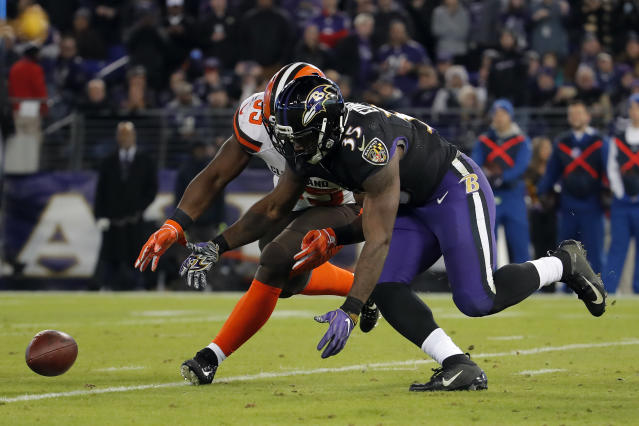 Baltimore Ravens running back Gus Edwards (35) and Cleveland Browns outside linebacker Genard Avery chase after a loose ball after Baltimore Ravens quarterback Lamar Jackson fumbled it in the first half of an NFL football game, Sunday, Dec. 30, 2018, in Baltimore. (AP Photo/Carolyn Kaster)