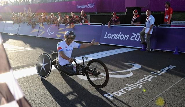 LONGFIELD, ENGLAND - SEPTEMBER 08: Alessandro Zanardi of Italy crosses the line to win silver in the Mixed H 1-4 relay on day 10 of the London 2012 Paralympic Games at Brands Hatch on September 8, 2012 in Longfield, England. (Photo by Gareth Copley/Getty Images)