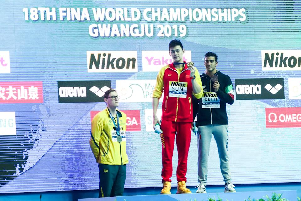 Mack Horton, pictured here refusing to stand next to Sun Yang at the world championships.