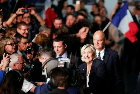 Marine Le Pen, French National Front (FN) political party leader and candidate for French 2017 presidential election, waves to supporters as she arrives surrounded by security members at a political rally in Bordeaux, France, April 2, 2017.  REUTERS/Regis Duvignau