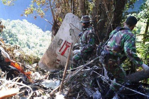"Indonesian soldiers search the the crash site of the Russian Sukhoi Superjet 100 in Mount Salak located in West Java province, May 12, 2012. Indonesian searchers have found the second ""black box"" of a new Russian passenger jet three weeks after it crashed into a mountain, killing all 45 aboard, an official said Thursday"