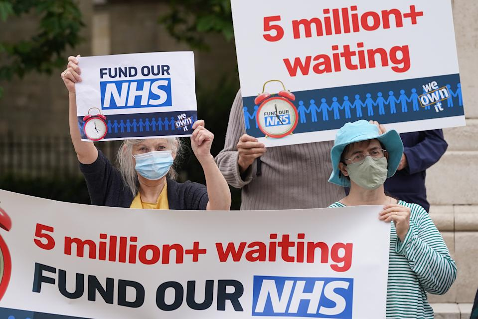 People take part in a protest outside Parliament in central London, calling on the government to tackle NHS waiting lists. Picture date: Saturday September 4, 2021.