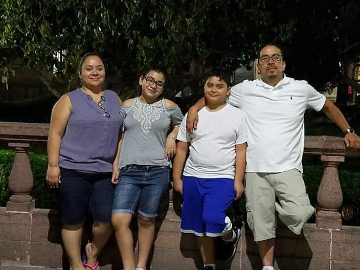Claudia Muniz, a West Side Chicago resident who works in sales at a bank, poses with her family.
