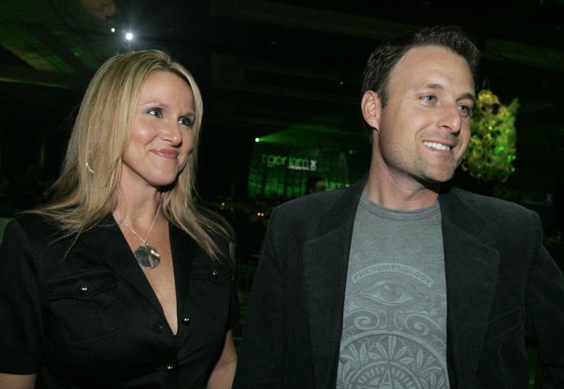 "FILE - In this Saturday, May 26, 2007 file photo, Television personality Chris Harrison, right, and his wife Gwen arrive for the 10th annual Tiger Jam at the Mandalay Bay in Las Vegas.  A spokesperson for ""The Bachelor"" host Chris Harrison and his wife, Gwen, said on Thursday, May 3, 2012, that they are ending their 18-year marriage.  (AP Photo/Jae C. Hong, File)"