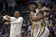 From left, Florida State's David Nichols, Terance Mann and M.J. Walker celebrate at the bench during the second half of a second round men's college basketball game against Murray State in the NCAA Tournament, Saturday, March 23, 2019, in Hartford, Conn. Florida State won 90-62. (AP Photo/Elise Amendola)