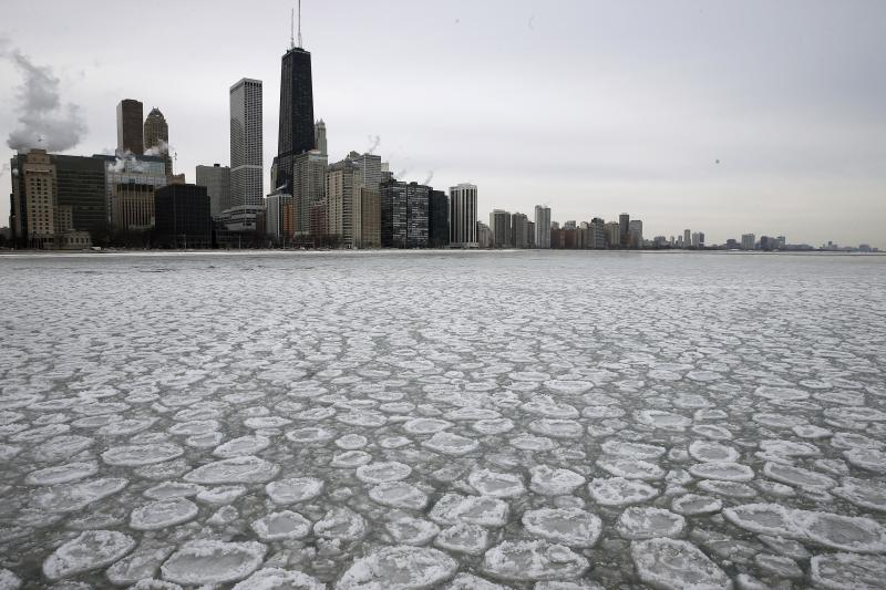The Chicago skyline is seen above a partially frozen Lake Michigan in Chicago
