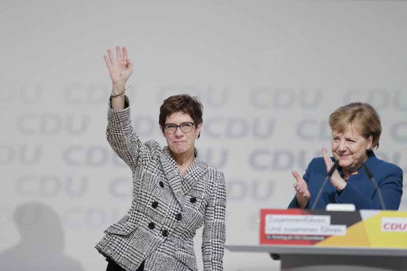 German Chancellor Angela Merkel, right, congratulates newly elected party chairwoman Annegret Kramp-Karrenbauer after the election at the party convention of the Christian Democratic Democratic Union CDU in Hamburg, northern Germany, Friday, Dec. 7, 2018. (AP Photo/Markus Schreiber)
