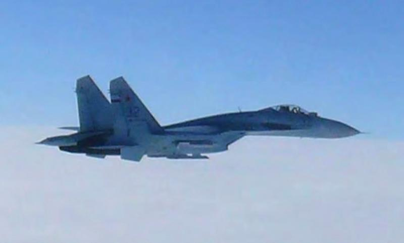 In this photo taken by Japan Air Self-Defense Force and released by the Joint Staff Office of the Defense Ministry of Japan, a Russian fighter jet SU-27 flies over the sea off the Japanese island of Hokkaido Thursday afternoon, Feb. 7, 2013. The Defense Ministry said two SU-27 jets, including the one shown in this photo, briefly intruded into Japanese airspace in the afternoon off the coast of Rishiri island on Hokkaido's west coast, prompting Japan's air force to scramble jets. (AP Photo/Joint Staff Office of Defense Ministry of Japan)
