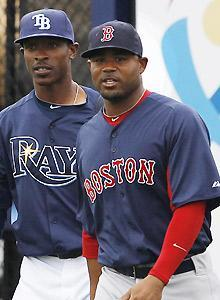 Carl Crawford, right, is fine with visiting former Rays teammates such as B.J. Upton