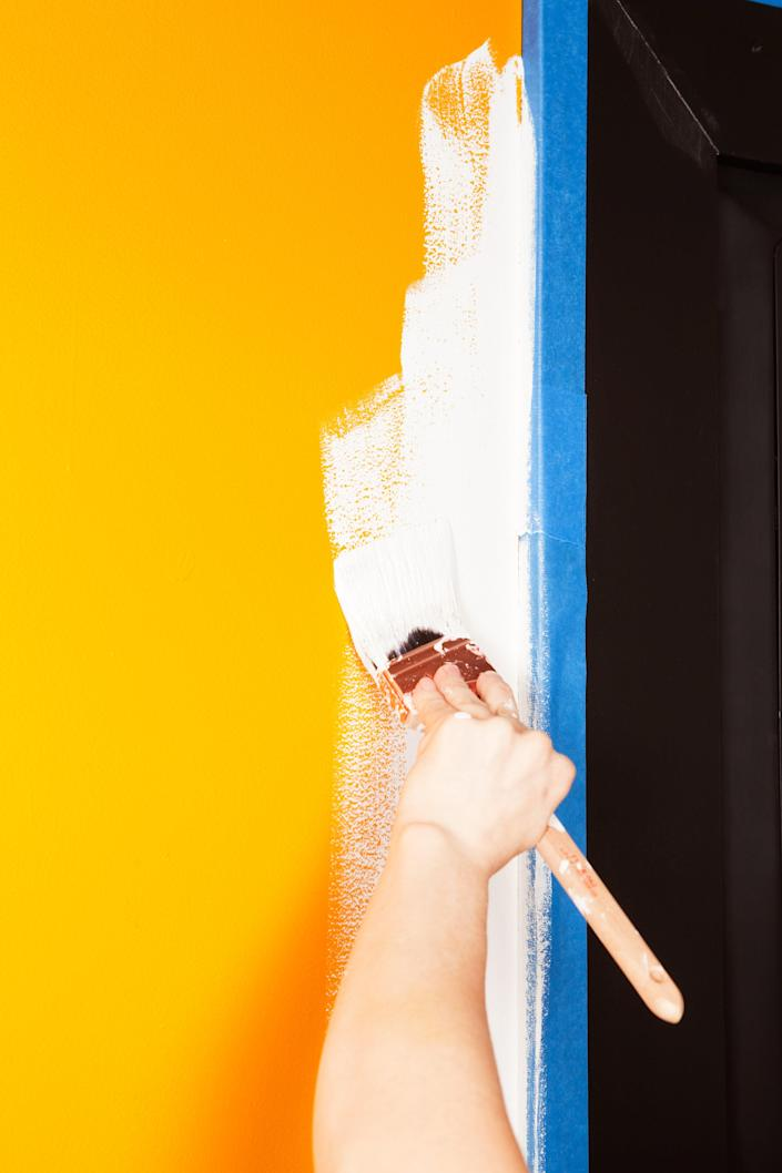 Start by cutting in near moldings and corners with a brush.