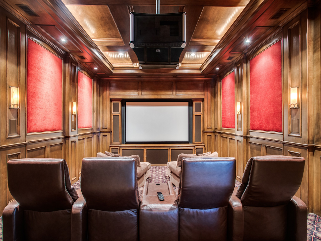"""<div class=""""caption""""> The plush home theater. </div> <cite class=""""credit"""">Photo: Couresty of Shoot2Sell photography</cite>"""
