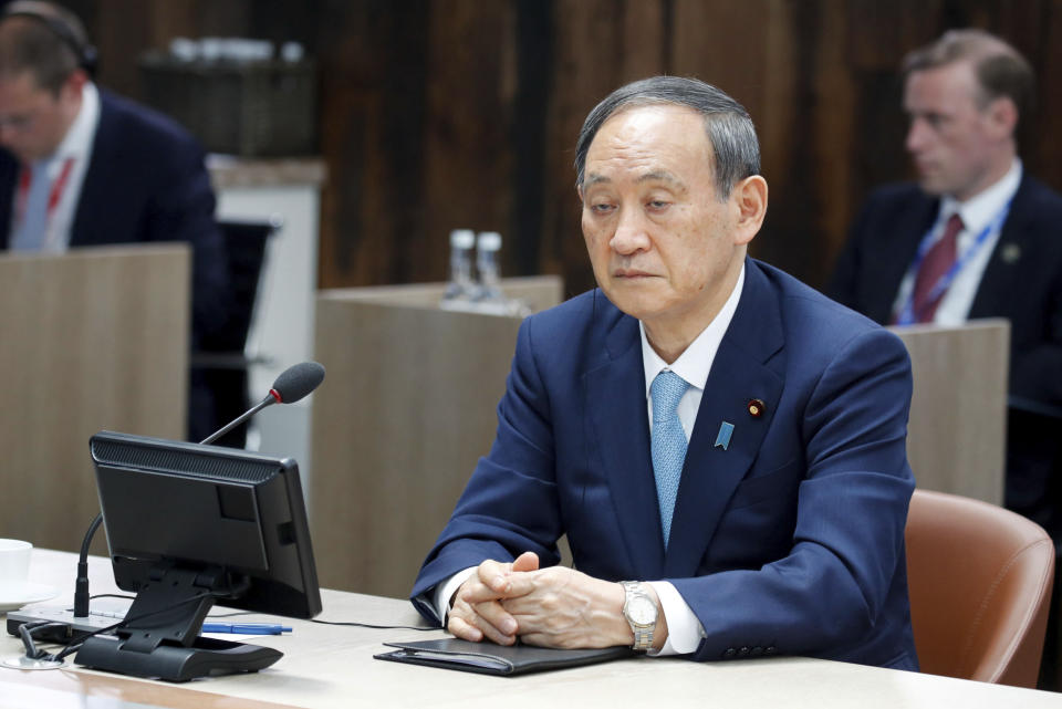 Japanese Prime Minister Yoshihide Suga attends a plenary session, during the G7 summit in Carbis Bay, England, Sunday June 13, 2021. (Phil Noble/Pool via AP)