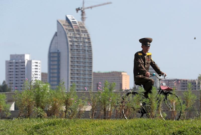 PYONGYANG, NORTH KOREA - SEPTEMBER 12, 2018: A North Korean serviceman riding a bicycle in a street in the city of Pyongyang. Alexander Demianchuk/TASS (Photo by Alexander Demianchuk\TASS via Getty Images)
