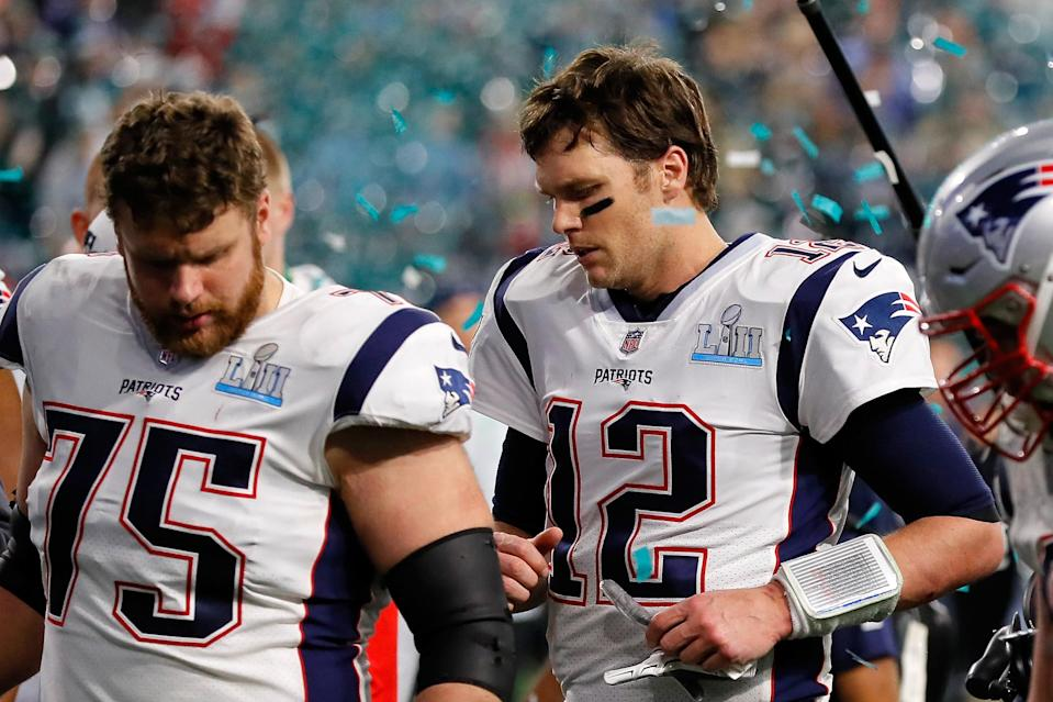 <p>Tom Brady #12 and Ted Karras #75 of the New England Patriots walk off the field after their teams 41-33 loss to the Philadelphia Eagles in Super Bowl LII at U.S. Bank Stadium on February 4, 2018 in Minneapolis, Minnesota. The Philadelphia Eagles defeated the New England Patriots 41-33. (Photo by Kevin C. Cox/Getty Images) </p>