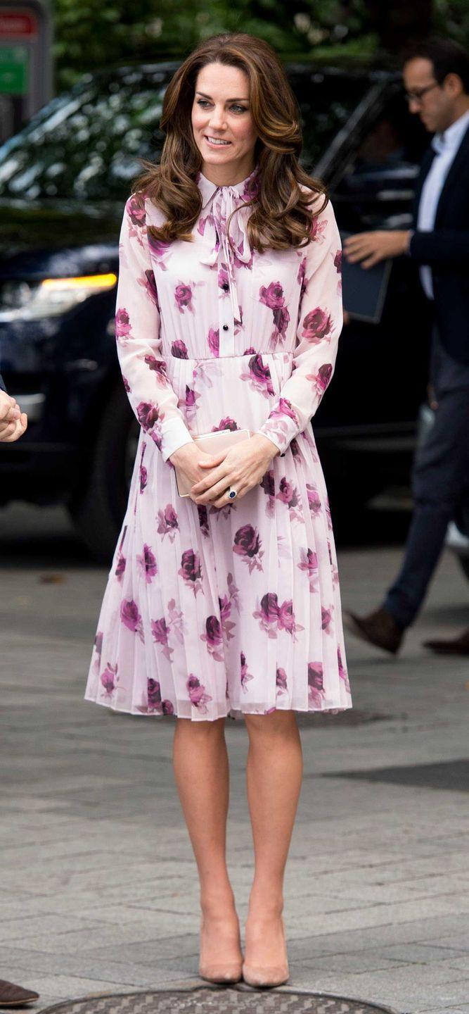 <p>During an appearance with Prince William and Prince Harry to honor World Mental Health Day, Duchess Kate chose a blush rose-printed chiffon dress by Kate Spade New York. The floral ensemble was accessorized with Gianvito Rossi pumps and her L.K. Bennett clutch.</p>