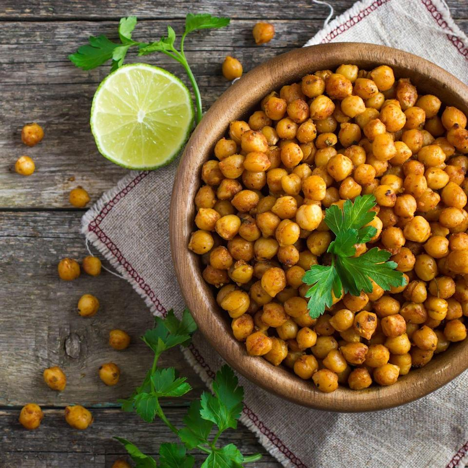 """<p>Being a regular garbanzo bean eater is tied to a lower risk for <a href=""""https://www.prevention.com/health/health-conditions/a19872320/colon-cancer-symptoms/"""" rel=""""nofollow noopener"""" target=""""_blank"""" data-ylk=""""slk:colorectal cancer"""" class=""""link rapid-noclick-resp"""">colorectal cancer</a>, found <a href=""""https://www.ncbi.nlm.nih.gov/pmc/articles/PMC4350074/"""" rel=""""nofollow noopener"""" target=""""_blank"""" data-ylk=""""slk:a review"""" class=""""link rapid-noclick-resp"""">a review</a> of 14 studies. Beans are chock-full of fibers that get fermented by the <a href=""""https://www.prevention.com/food-nutrition/healthy-eating/g23310235/probiotic-foods-for-gut-health/"""" rel=""""nofollow noopener"""" target=""""_blank"""" data-ylk=""""slk:good bacteria in our guts"""" class=""""link rapid-noclick-resp"""">good bacteria in our guts</a> and transformed into inflammation-fighting short chain fatty acids. And these acids are thought to potentially have cancer-fighting effects, the <a href=""""https://www.aicr.org/cancer-prevention/food-facts/dry-beans-and-peas-legumes/"""" rel=""""nofollow noopener"""" target=""""_blank"""" data-ylk=""""slk:AICR"""" class=""""link rapid-noclick-resp"""">AICR</a> notes.</p><p><strong>Try it: </strong><a href=""""https://www.prevention.com/food-nutrition/recipes/a24790179/low-carb-chickpea-waffles-recipe/"""" rel=""""nofollow noopener"""" target=""""_blank"""" data-ylk=""""slk:Savory Low-Carb Chickpea Waffles"""" class=""""link rapid-noclick-resp"""">Savory Low-Carb Chickpea Waffles</a></p>"""