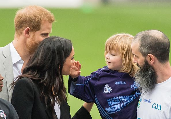 Prince Harry, Duke of Sussex and Meghan, Duchess of Sussex meet Walter Cullen, aged 3 at Croke Park, home of Ireland's largest sporting organisation, the Gaelic Athletic Association on July 11, 2018 in Dublin, Ireland.