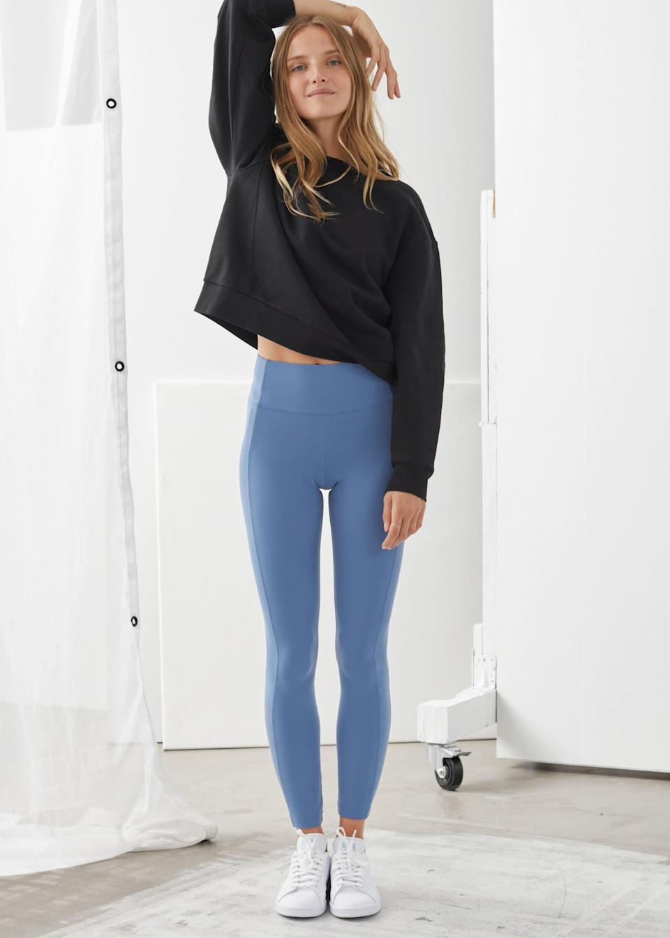 "<br><br><strong>& Other Stories</strong> Quick-Dry Yoga Tights, $, available at <a href=""https://go.skimresources.com/?id=30283X879131&url=https%3A%2F%2Fwww.stories.com%2Fen_usd%2Fclothing%2Ftrousers%2Fslim-fit-trousers%2Fproduct.quick-dry-yoga-tights-blue.0848275003.html"" rel=""nofollow noopener"" target=""_blank"" data-ylk=""slk:& Other Stories"" class=""link rapid-noclick-resp"">& Other Stories</a>"