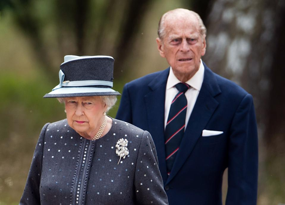 Britain's Queen Elizabeth II and The Duke of Edinburg, Prince Philip (L) visit the memorial site of former Nazi concentration camp Bergen-Belsen on June 26, 2015.  AFP PHOTO / POOL / JULIAN STRATENSCHULTE        (Photo credit should read JULIAN STRATENSCHULTE/AFP via Getty Images)