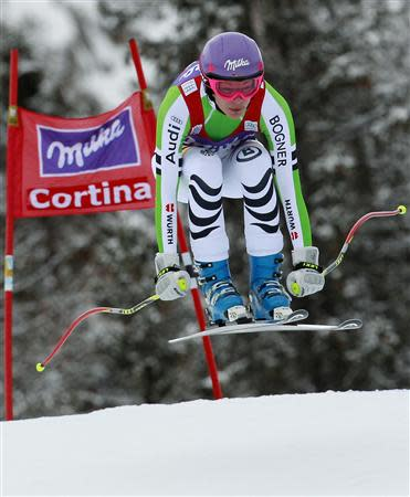 Maria Hoefl-Riesch of Germany clears a gate during the women's FIS World Cup Downhill race in Cortina D'Ampezzo January 24, 2014. REUTERS/Alessandro Garofalo