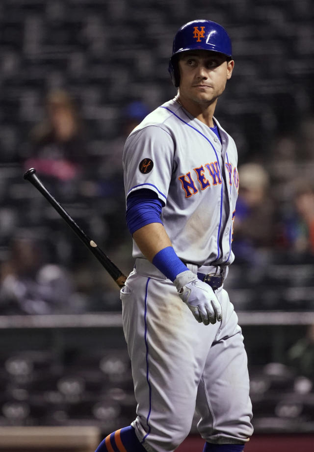 New York Mets' Michael Conforto looks back as he heads to the dugout after striking out during the seventh inning of the team's baseball game, against the Colorado Rockies on Tuesday, June 19, 2018, in Denver. (AP Photo/Jack Dempsey)