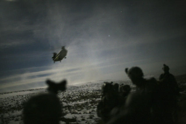 <p>A Chinook helicopter lands to pick up U.S. soldiers of the 101st Airborne Division following a night raid in Yahya Khel, Paktika province, Feb. 21, 2011. (Photo: Matt Robinson/Reuters) </p>