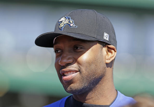 Retired NBA All-Star Tracy McGrady wears a baseball cap before working out at the Sugar Land Skeeters baseball stadium Wednesday, Feb. 12, 2014, in Sugar Land, Texas. McGrady hopes to try out as a pitcher for the independent Atlantic League Skeeters. (AP Photo/Pat Sullivan)