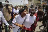 People march to demand justice for slain Haitian President Jovenel Moise in Lower Delmas, a district of Port-au-Prince, Haiti, Monday, July 26, 2021. Moise was assassinated on July 7 at his home. (AP Photo/Joseph Odelyn)