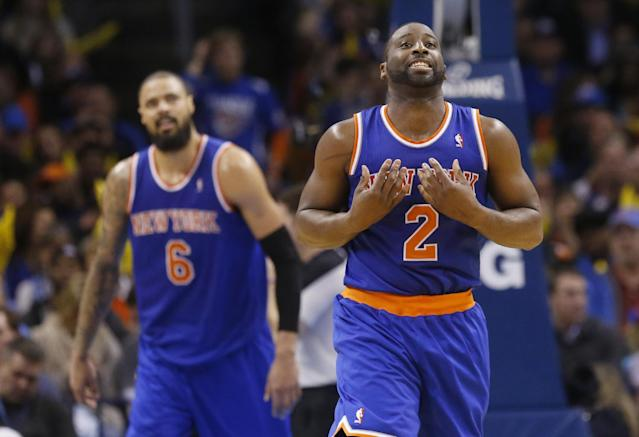In this Feb. 9, 2014, photo, New York Knicks guard Raymond Felton (2) reacts after being called for a foul during an NBA basketball game against the Oklahoma City Thunder in Oklahoma City. At left is teammate Tyson Chadler. The Dallas Mavericks and the Knicks have agreed to a trade that would bring Chandler back to the Mavericks three years after he helped them win a championship only to leave right away in free agency. Two people with knowledge of the deal said Wednesday, June 25, 2014, the Mavericks would send guards Jose Calderon and Shane Larkin and center Samuel Dalembert to the Knicks for Chandler and Felton. The people spoke on condition of anonymity because the deal hasn't been announced. (AP Photo/Sue Ogrocki)