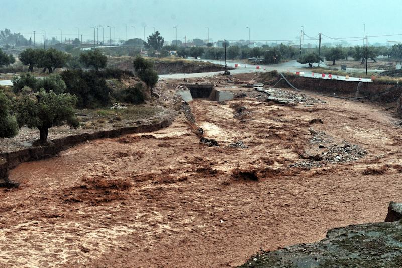 A picture shows damage and floodwaters in the town of Mandra. (Valerie Gache/AFP/Getty Images)