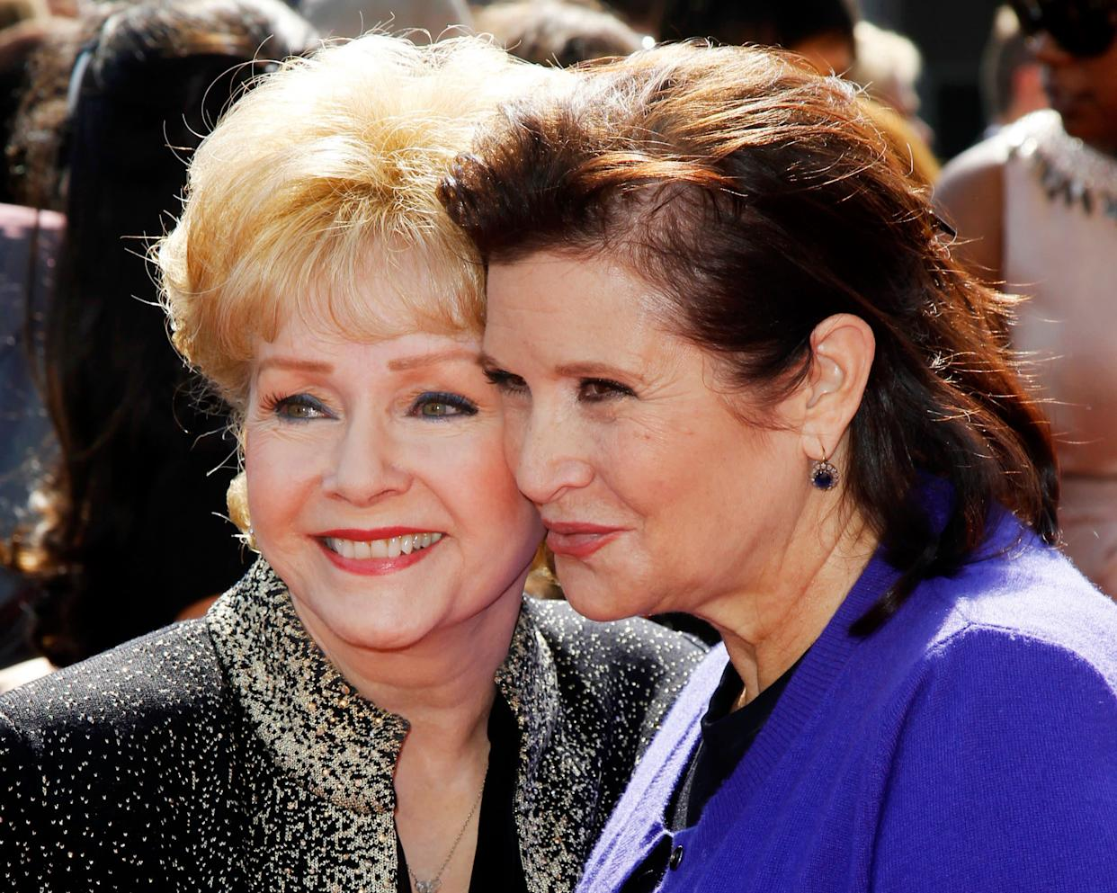 Debbie Reynolds and Carrie Fisher arrive at the Primetime Creative Arts Emmy Awards in Los Angeles on Sep.10, 2011.