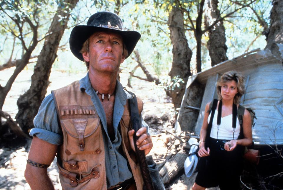Paul Hogan and Linda Kozlowski in a scene from the film 'Crocodile Dundee', 1986. (Photo by Paramount/Getty Images)