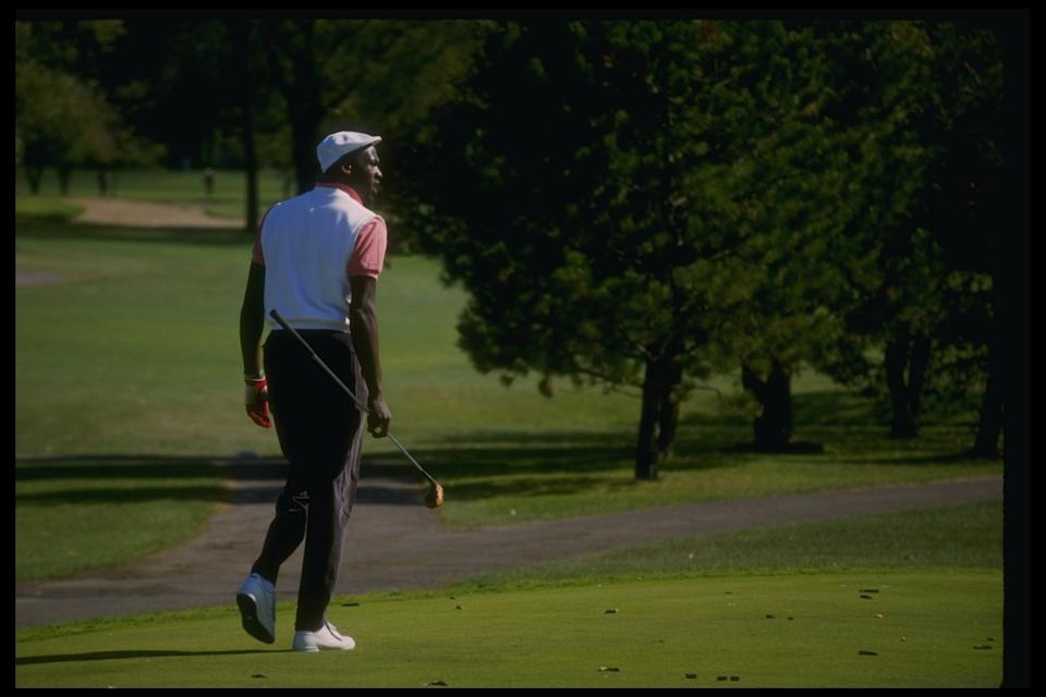 Michael Jordan wears clothes that fit at a golfing event in 1989. (Getty Images)
