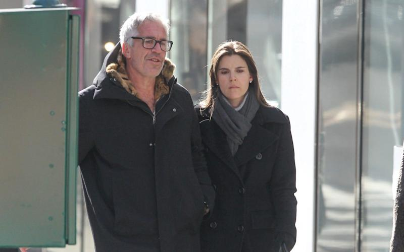 Jeffrey Epstein is spotted walking with Sarah Kellen along Madison Avenue in New York City in 2012 - The Mega Agency