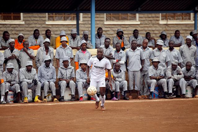 <p>Kenyan prisoners watch a mock World Cup soccer match at the Kamiti Maximum Security Prison, Kenya's largest prison facility, near Nairobi, on June 14, 2018. (Photo: Baz Ratner/Reuters) </p>