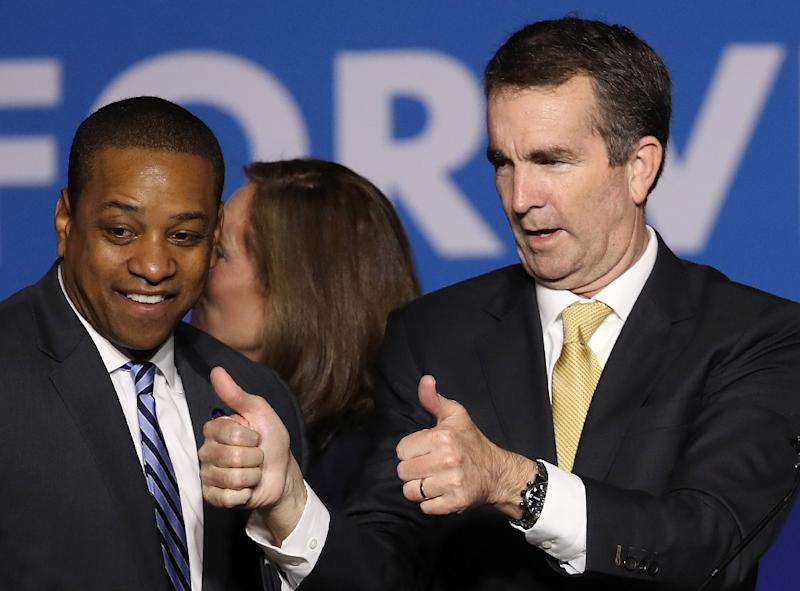 Governor Ralph Northam (R) and Lieutenant Governor Justin Fairfax (L) are both under fire in Virginia (AFP Photo/WIN MCNAMEE)