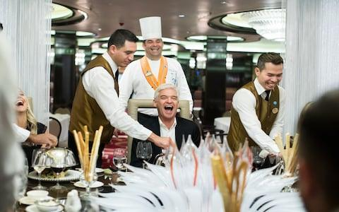 Phillip Schofield with his daughter and ship staff around a dinner table