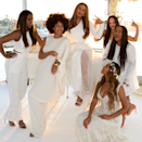 <p>Along the same lines as Solange's all-white attire, the sisters happily posed alongside their mom Tina as she said her vows in April of 2015. <i>(photo: Beyonce.com)</i></p>