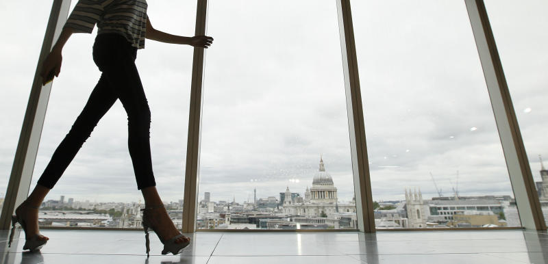 FILE - In this Sunday, Sept. 16, 2012 file photo, a model walks past a window with a view of St Paul's Cathedral in the background during the presentation of the Matthew Williamson Spring/Summer 2013. London Fashion Week kicks off on Friday Sept. 13, 2013. ( AP Photo/Alastair Grant, File)