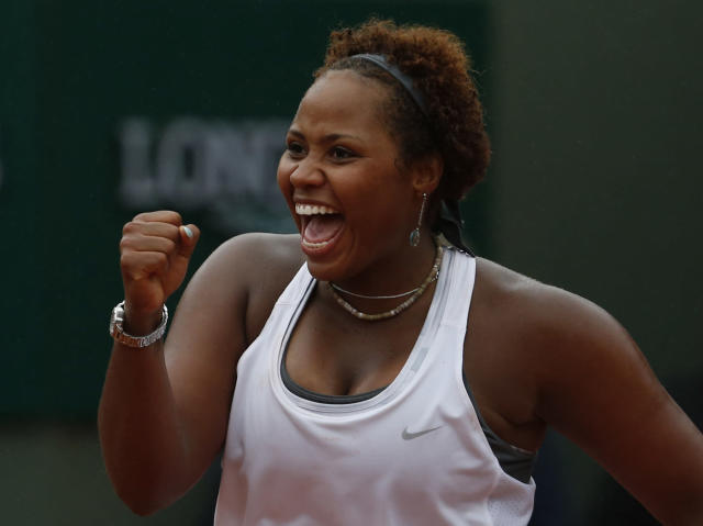 Taylor Townsend, of the U.S, clenches her fist as she defeats France's Alize Cornet after their second round match of the French Open tennis tournament at the Roland Garros stadium, in Paris, France, Wednesday, May 28, 2014. (AP Photo/Darko Vojinovic)