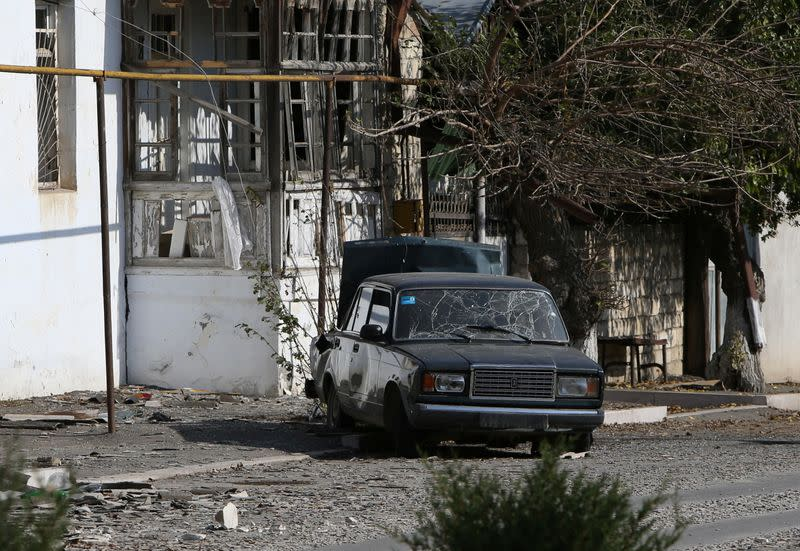 A view shows a car damaged by shelling during the military conflict over the breakaway region of Nagorno-Karabakh, in Martuni