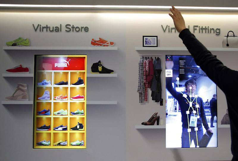 Jung Jin Bae, of South Korea, tests a motion sensor at the LG booth at the International Consumer Electronics Show in Las Vegas, Monday, Jan. 7, 2013. The 2013 International CES gadget show, the biggest trade show in the Americas, is taking place in Las Vegas this week. (AP Photo/Jae C. Hong)