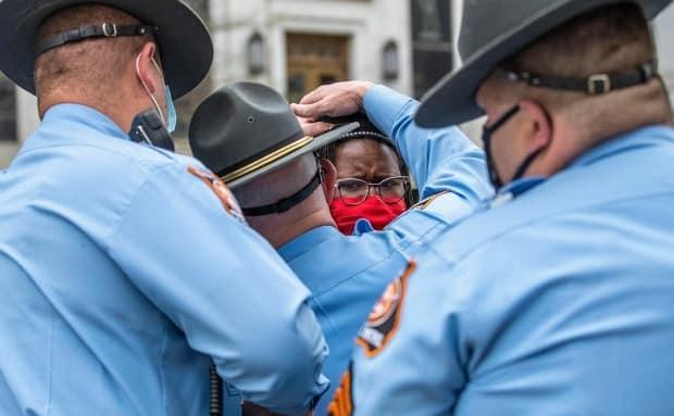 State lawmaker Park Cannon is seen here being arrested after trying to knock on the governor's office door to protest the law last month. She calls it a throwback to the racist Jim Crow era.