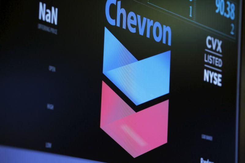 The logo of Chevron is shown on a monitor above the floor of the New York Stock Exchange in New York