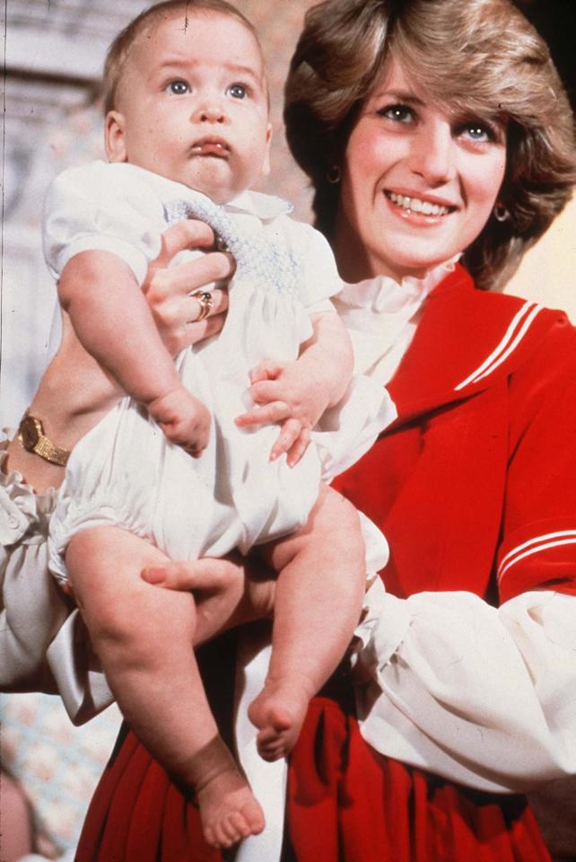 <p>In 1982, Princess Diana posed for a Christmas portrait with her son, Prince William. Upon closer inspection, it seems the royal is not wearing her engagement ring but a sapphire cabochon ring. It is widely speculated that she swapped her jewelry so she wouldn't risk scratching her newborn. (Photo: PA) </p>