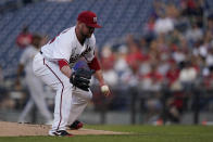 Washington Nationals starting pitcher Jon Lester fields a ball hit by Pittsburgh Pirates' Erik Gonzalez (2) during the first inning of a baseball game, Monday, June 14, 2021, in Washington. Lester made the out at first. (AP Photo/Carolyn Kaster)