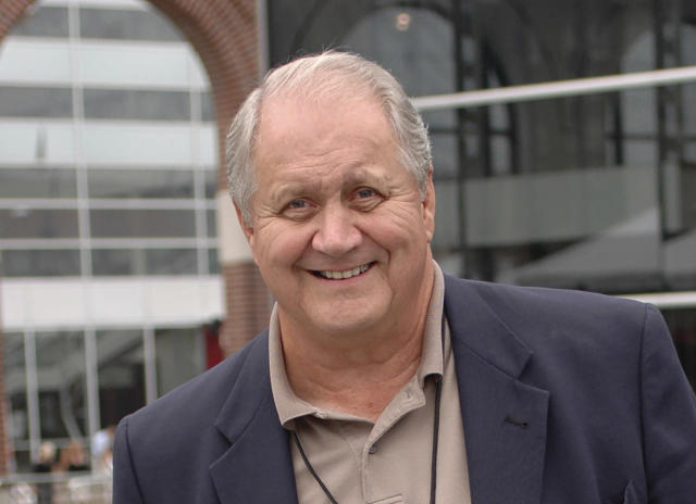FILE - In this Aug. 10, 2006, file photo, Jim Houston, smiles as he walks through a reception for players being enshrined into the College Football Hall of Fame, in South Bend, Ind. Houston's widow would keep notes on her husband's deteriorating condition in a three-ring binder so she would be prepared for the day when he needed full-time care. (AP Photo/Joe Raymond, File)
