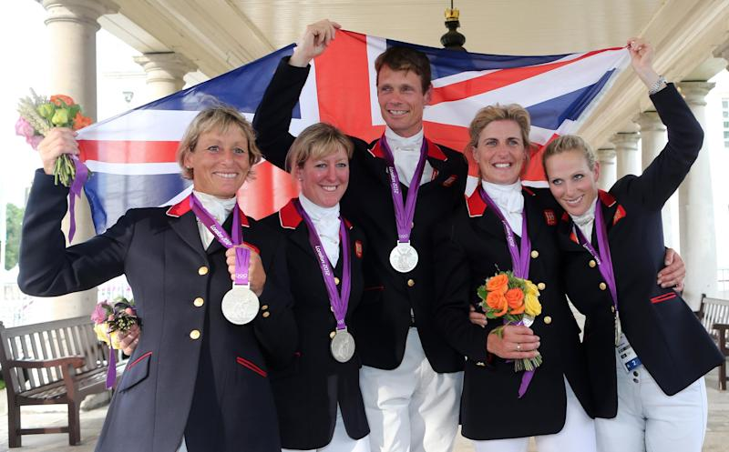 Zara Phillips (right) celebrating with the team after finishing second in the Team Eventing at the London Olympic Games