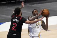 Toronto Raptors' Jalen Harris (2) defends as Dallas Mavericks forward Dorian Finney-Smith (10) works to the basket in the first half of an NBA basketball game in Dallas, Friday, May 14, 2021. (AP Photo/Tony Gutierrez)